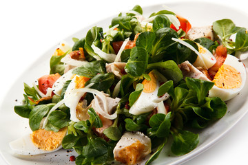 Salad with grilled chicken and boiled eggs