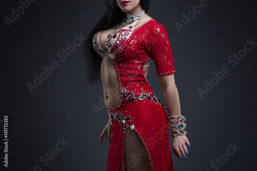"""""""Exotic Eastern Women Performs Belly Dance In Ethnic Red"""