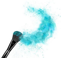 Make up brush with powder splash isolated on white background