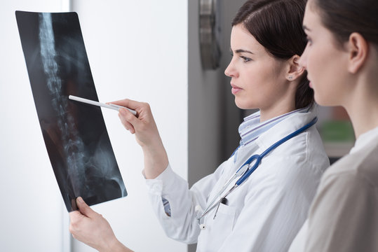 Doctor examining patient's x-ray
