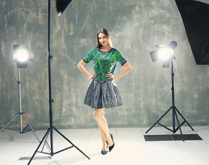 Young beautiful model posing in professional photo studio