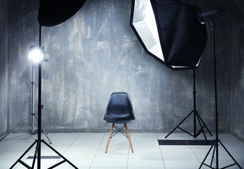 Modern photo studio interior with professional lighting equipment