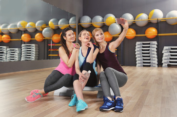 Young women taking selfie in gym