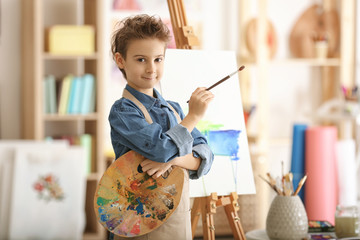Cute little artist in studio