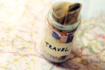 travel budget concept, money savings in a glass jar