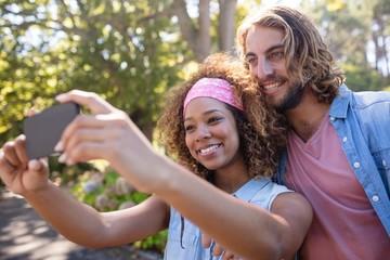 Happy couple taking selfie on mobile phone