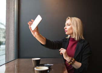 Coquettish woman taking selfie