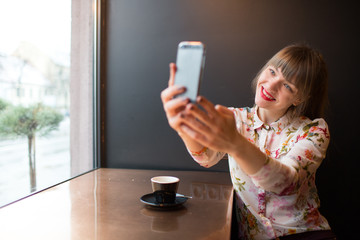 Trendy young woman taking selfie