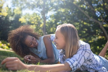 Female friends having fun in park