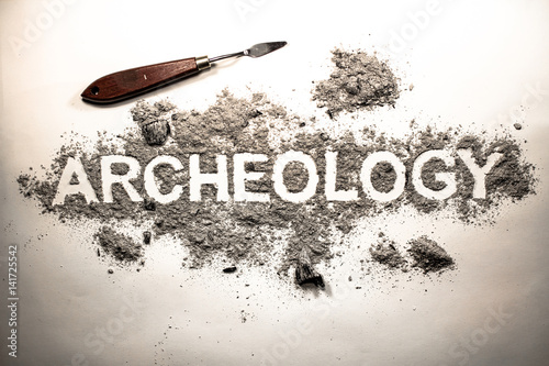 Archeology word written in letters on a pile of ash dirt for Soil 8 letters