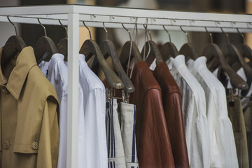 Fancy clothing hanging on racks in a store