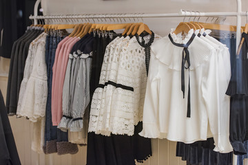 Women clothes on racks in a store in London.