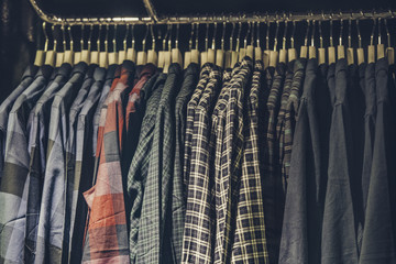 Men shirts on racks in a clothing shop in London