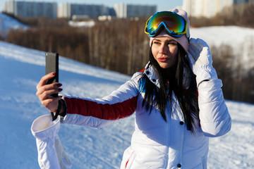 Brunette doing selfie on winter