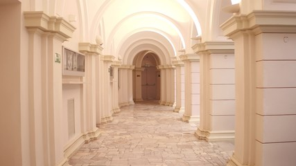 Lit old building passageway and columns Wall mural