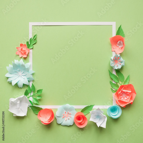 Square frame with color paper flowers on the green background flat square frame with color paper flowers on the green background flat lay nature concept mightylinksfo