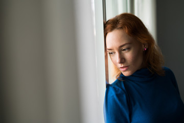Pensive woman at the window