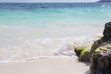 The Caribbean sea and the white sand beach.