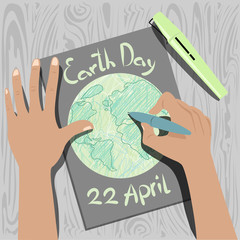the child draws the earth. earth day. vector illustration
