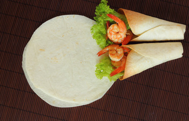 Burritos wraps with shrimp and vegetables.