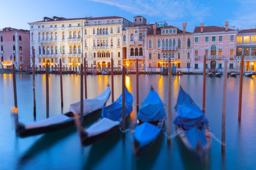 Europe, Italy, Veneto, Venice.Gondolas moored in the Grand Canal at sunset.