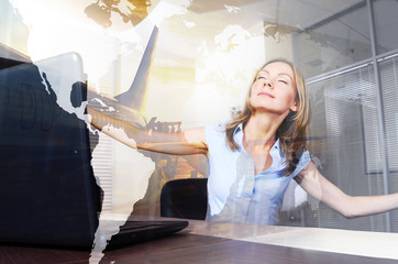 Vacation daydreams. Smiling woman with closed eyes is virtually flying in a modern office.