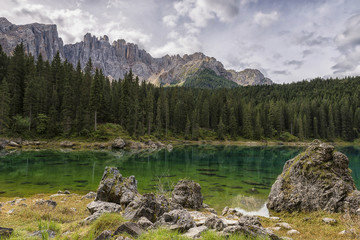 Karersee lake and the Latemar mountain group in a cloudy day, Dolomites