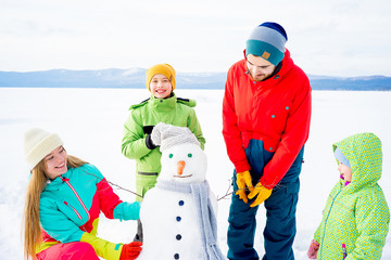 Family making a snowman