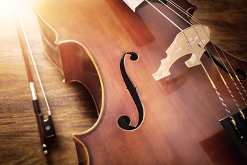 Cello on wood background