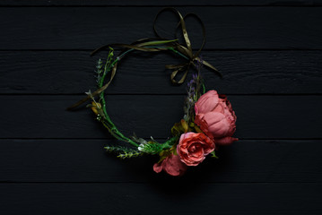 Flower wreath hairpin with flowers isolated on black background
