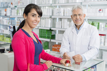 Confident Chemist And Customer With Prescription