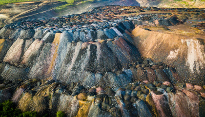 landscape with multicolored rock dumps from quarries, aerial photo