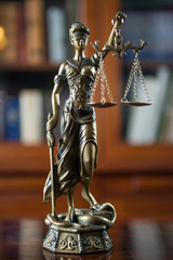 Law Concept. Judges Gavel And Scale Of Justice. wooden desk, books