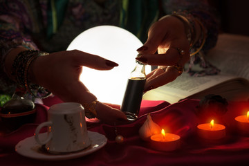 Hands of an fortune teller with holding love potion