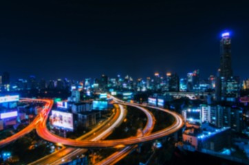 abstract blurred night city background, blue color tone effect.