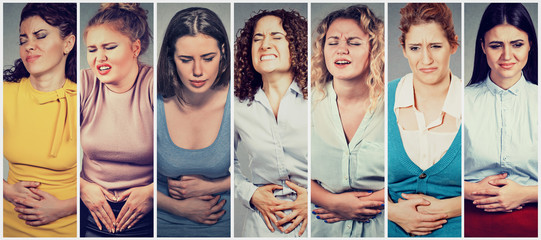 Group of young women with hands on stomach having bad aches pain