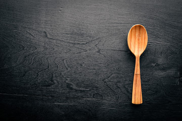Wooden spoon on a black background Wooden.