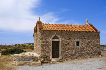 small chapel with orange tiles and a blue sky