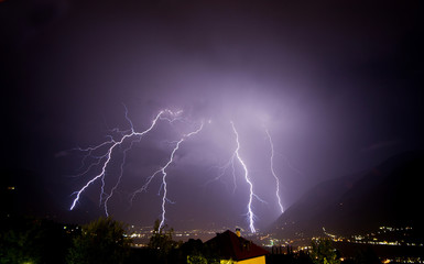 A strong thunderstorm discharge many lightning on the Meran city, during the night. Passiria Valley, Trentino Alto Adige, Italy