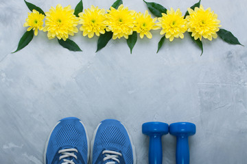 Summer flatlay composition with sport equipment and flowers