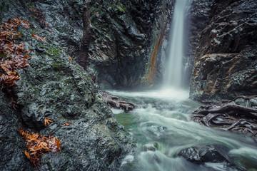 Mountain waterfall at fall
