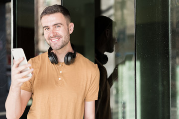 man with mobile phone and headphones smile