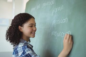Schoolgirl pretending to be a teacher in classroom