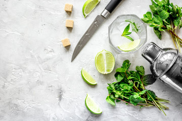 making mojito on stone background top view