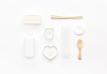 white set of cosmetics for spa on table background top view