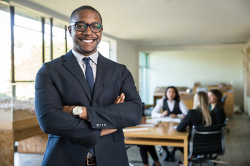 Smiling owner ceo at office work place portrait of worker in suit glasses and tie looking handsome