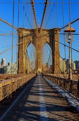 Stars and stripes flying on Brooklyn Bridge