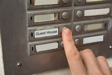 Person Clicking On Door Bell Button
