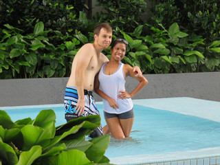 Couple in love enjoying summer in swimming pool