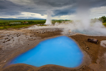 Strokkur geyser, geothermal area beside the Hvítá River, Iceland, Europe.  Most famous Iceland geysers.
